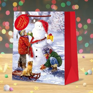 christmas gift bag large children building snowman