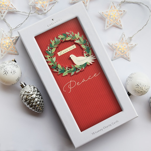 Irish charity christmas card with a wreath and dove