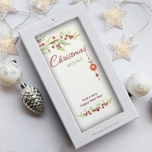 christmas card with berries and Christmas bauble